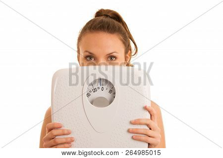 Beautiful Young Active Fit Woman Hold Scale As Gesture Of Loosing Weight Isolated Over White Backgro