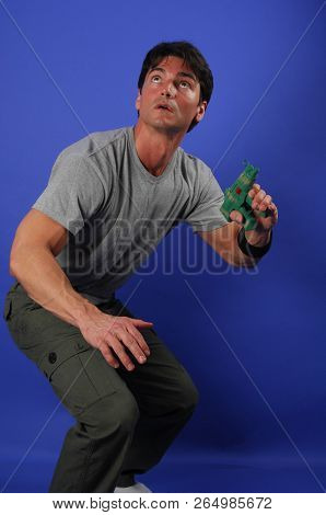 The Sexy Man Prepares For Battle With A Gun.