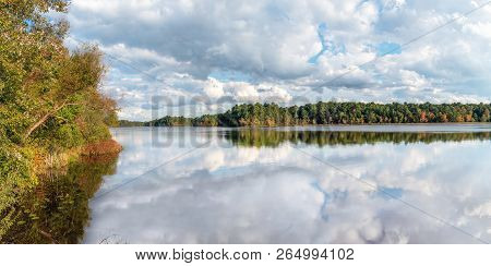 A Panoramic Autumn View Of Prospertown Lake In Monmouth County New Jersey.