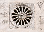 Close up of a decorative air hole on wall. poster