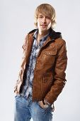 Handsome young man in leather jacket, studio portrait poster