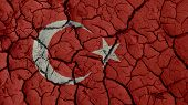 Political Crisis Or Environmental Concept: Mud Cracks With Turkey Flag poster