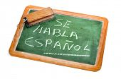 sentence Spanish is spoken written in spanish on a chalkboard poster