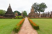Landscape view Wat Mahathat Sukhothai Thailand Ancient capital of Sukhothai, Thailand Historical Park is the UNESCO world heritage A historic place And the old capital in the past. poster