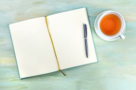 An Overhead Photo Of An Open Journal Notebook With A Pen And A Cup Of Tea, Shot From Above, A Diary