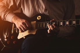 The Artist Plays The Blues On Stage. Close-up