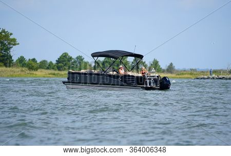 Bethany Beach, Delaware, U.s.a - September 2, 2019 - Anglers On The Pontoon Boat Fishing For Flounde