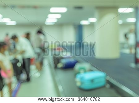 Blurred Image Background Of Passengers Wait For Luggage At Baggage Claim In Airport. Vintage Color I