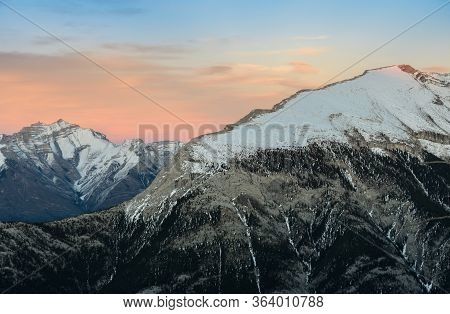 Stunning Canadian Rocky Mountains Twilight Scene Of Snow Capped Mountain At Banff National Park In A