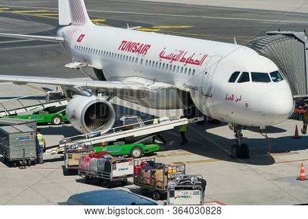 Istanbul / Turkey - September 14, 2019: Airport Workers Loading The Luggage Bags Into A Tunisair Air