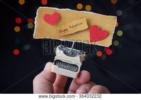 Valentine's Day Wording On Torn  Typewriter As Love Concept