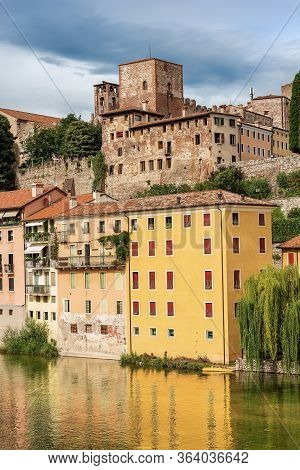 Castello Degli Ezzelini. Medieval Castle In Bassano Del Grappa And The River Brenta Seen From The Br