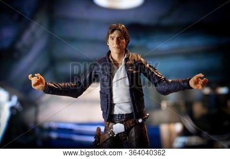 APRIL 29 2020: Recreation of a scene from Star Wars The Empire Strikes Back where Han Solo makes a gesture in front of the Millennium Falcon - Hasbro action figure