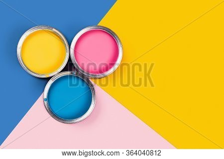 Repare Concept. Tricolor Blue, Yellow, Pink Background With Three Colors Paint Cans. Flat Lay, Top V