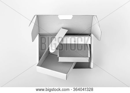 Opened White Boxes On White Background, Top View