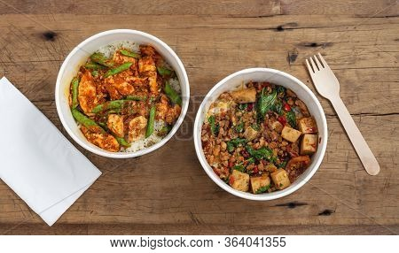 Stir Fried Pork And Chicken With Rice In Food Paper Boxes
