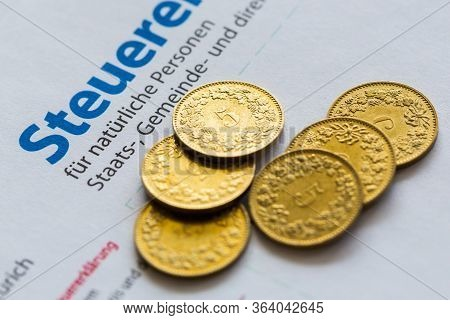 Six Golden Coins On Paper Of Swiss Tax Declaration Form, Canton Of Zurich