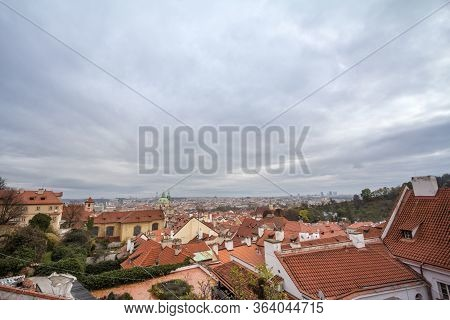 Panorama Of Prague, Czech Republic, Seen From The Top Of The Castle, During An Autumn Cloudy Afterno
