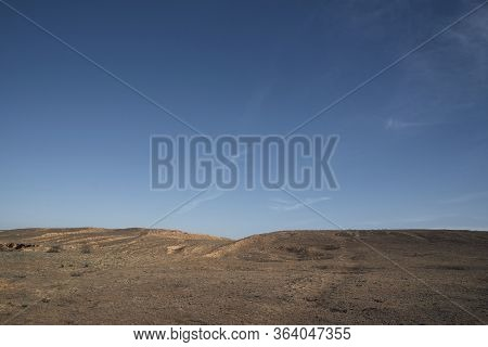 A Hill In The Steppe Under A Blue Sky