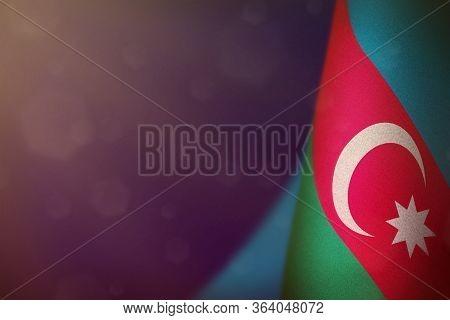 Azerbaijan Hanging Flag For Honour Of Veterans Day Or Memorial Day On Blue Dark Velvet Background. A