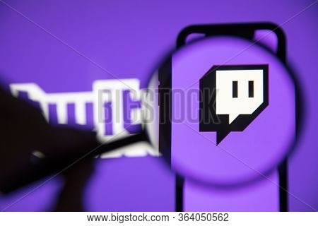 London, Uk - April 30 2020: Twitch Live Gaming Logo Under A Magnifying Glass