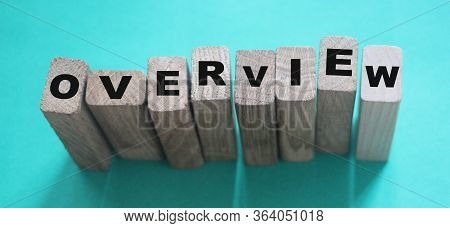 Word Overview On A Wooden Cubes. Conclusion Summary Concept. Education Concept