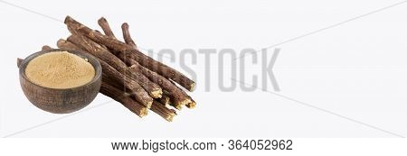 Closure Of Ayurvedic Herb Licorice Root, Licorice Root, Mulethi Or Glycyrhiza Glabra Root On A Woode