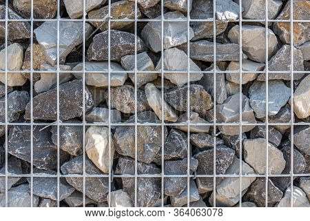 Gabion Wall Closeup. Textured Background. Gabion Is Stones In Wire Mesh Used For Erosion Control