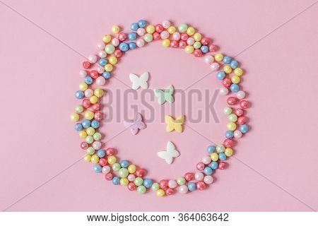 Pastry Sprinkles Are Scattered In The Form Of A Circle, Inside It Are Enclosed Colorful Butterflies