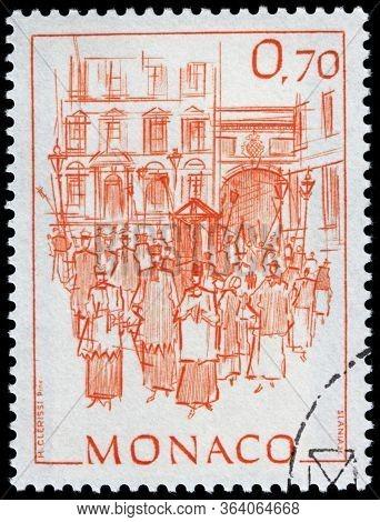 Luga, Russia - April 10, 2020: A Stamp Printed By Monaco Shows View Of Procession In Monte Carlo, Ci
