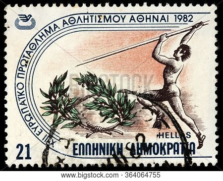 Luga, Russia - October 15, 2019: A Stamp Printed By Greece Shows Pole Vaulter Participating In The E