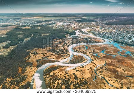 Belarus, Europe. Aerial View Curved River And Small Town In Early Spring Landscape. River Bends Curv