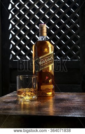 Phuket, Thailand- March 2020. Johnnie Walker Red Label Blended Whisky Isolated On Color  Background.