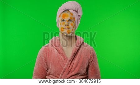 Portrait Of Young Transsexual Man Wearing Pink Bathrobe And Towel On His Head Looking At Camera Wear