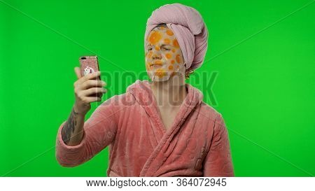 Portrait Of Young Transsexual Man Wearing Pink Bathrobe And Face Cleaning Mask After Shower Doing Be