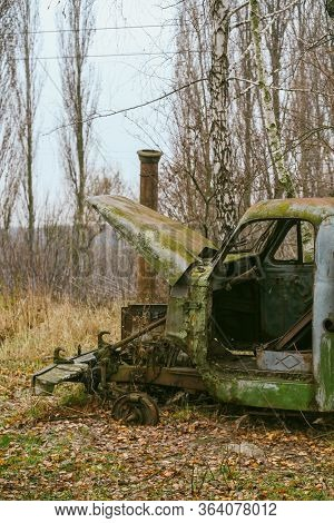 Old Truck. Abandoned Car. Rusty Car On A Background Of Yellow Leaves