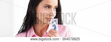 Woman Stands Office And Puts Bank Card Her Mouth. Credit Limit For Online Purchases. Transaction Con