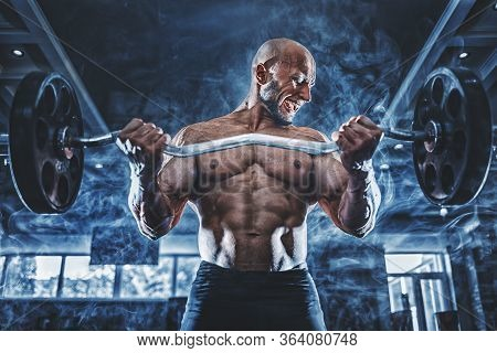Muscular Man Working Out In Gym Doing Exercises With Dumbbells At Biceps, Strong Male Naked Torso Ab