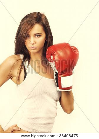 Attractive young woman wearing boxing gloves poster