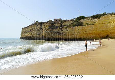 Senhora Da Rocha Beach,, Algarve, Portugal - October 02, 2014 : Tourists Enjoying The August Sunshin
