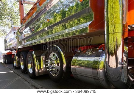 The Reflection Of Greenery In The Chrome Surfaces Of The Vehicle. A Real American Truck.