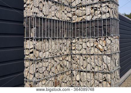 Gabion Wall. A Fragment Of The Fence Surrounding The Property.