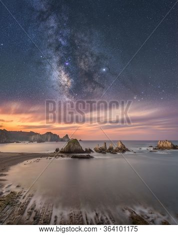 Coastal Landscape At Night With The Sea And The Milky Way In The Sky
