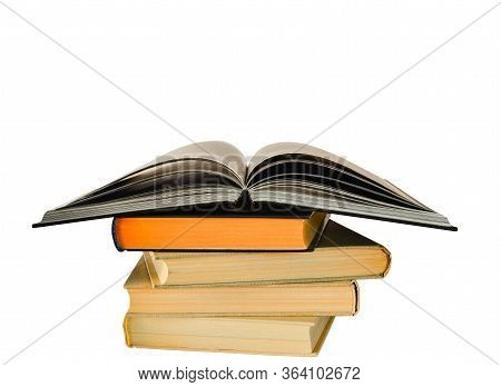 A Stack Of Books With A Textbook Spread Out On Top With A Blurry Cover For Education And Training In
