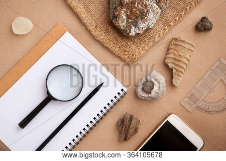 Geology Rock Laboratory. Stone Samples, Loop, Notebook And Mobile Phome At Geological Laboratory. La