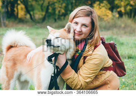 Girl Plays With Husky White Ginger Dog In Park In Fresh Air. Feeling Portrait Of Woman And Cute Foxy