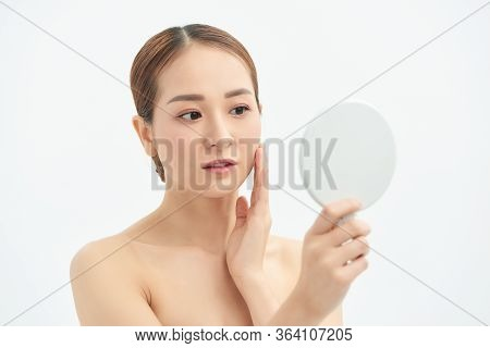 Beautiful Asian Woman Checking Her Skin, Skin Care, Acne Treatment. Spa And Skincare Concept.