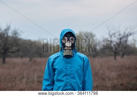 Outside Picture Of Stalker Wearing Blue Jacket And Gas Mask, Spending Time Alone, Being At 30 Km Exc