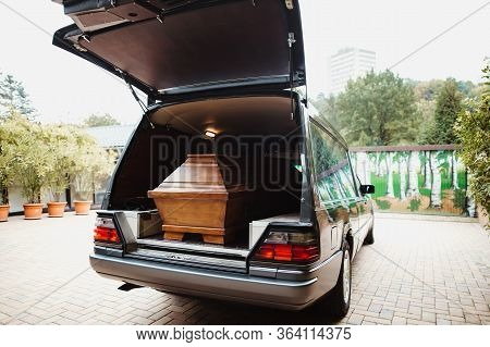 Photo Of A Coffin Car At A Funeral