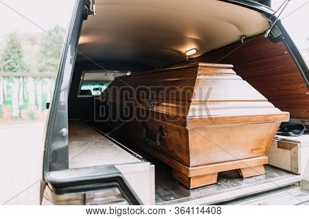 Photo Of A Coffin In The Back Of Car